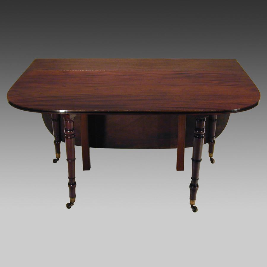 Georgian mahogany campaign drop-leaf dining table