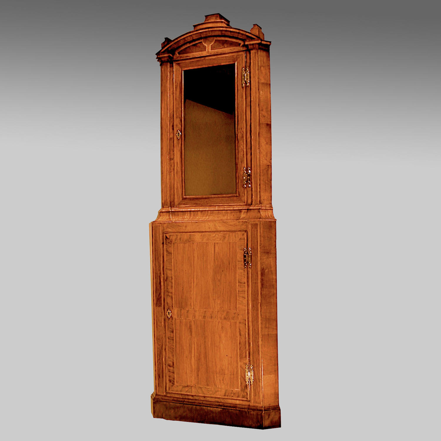 Early 18th century walnut standing corner cupboard