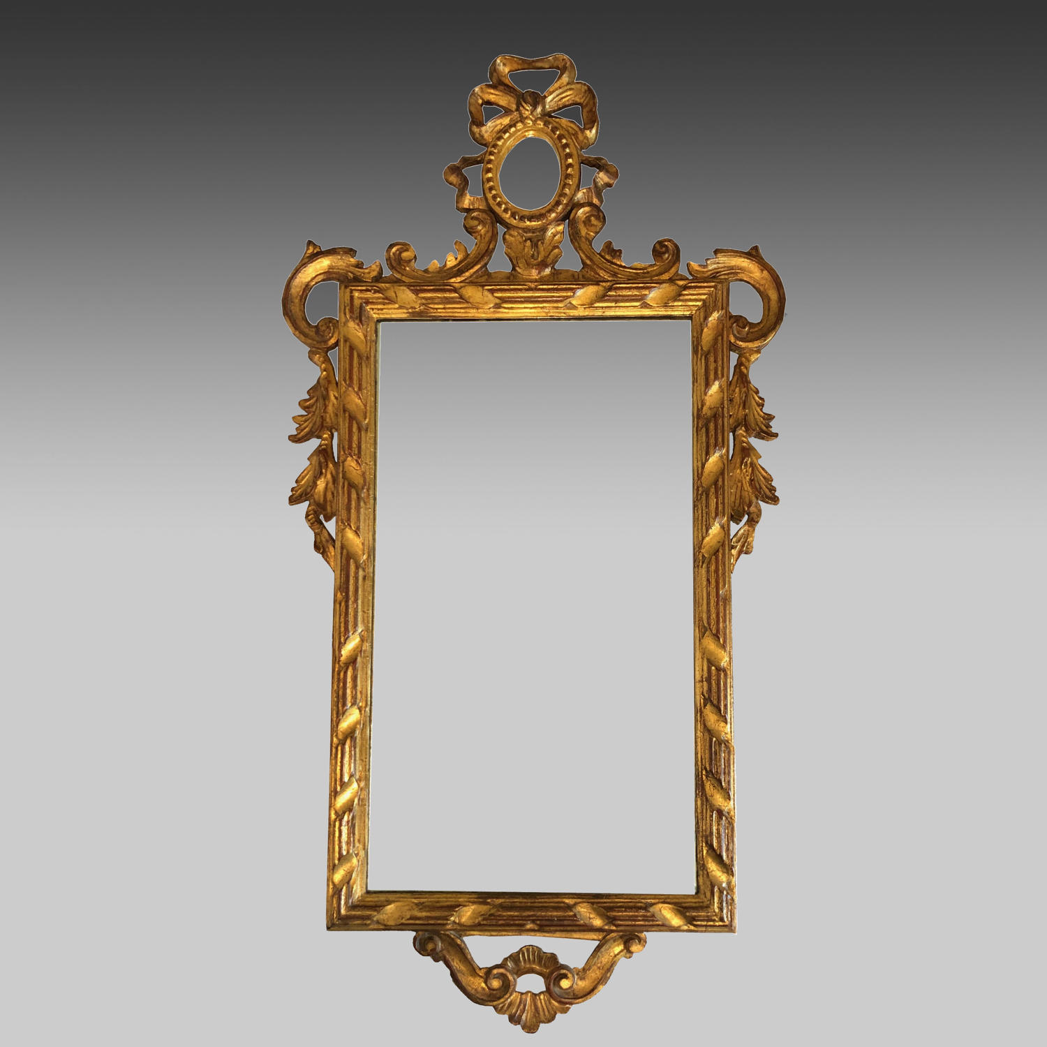Continental carved giltwood portrait mirror
