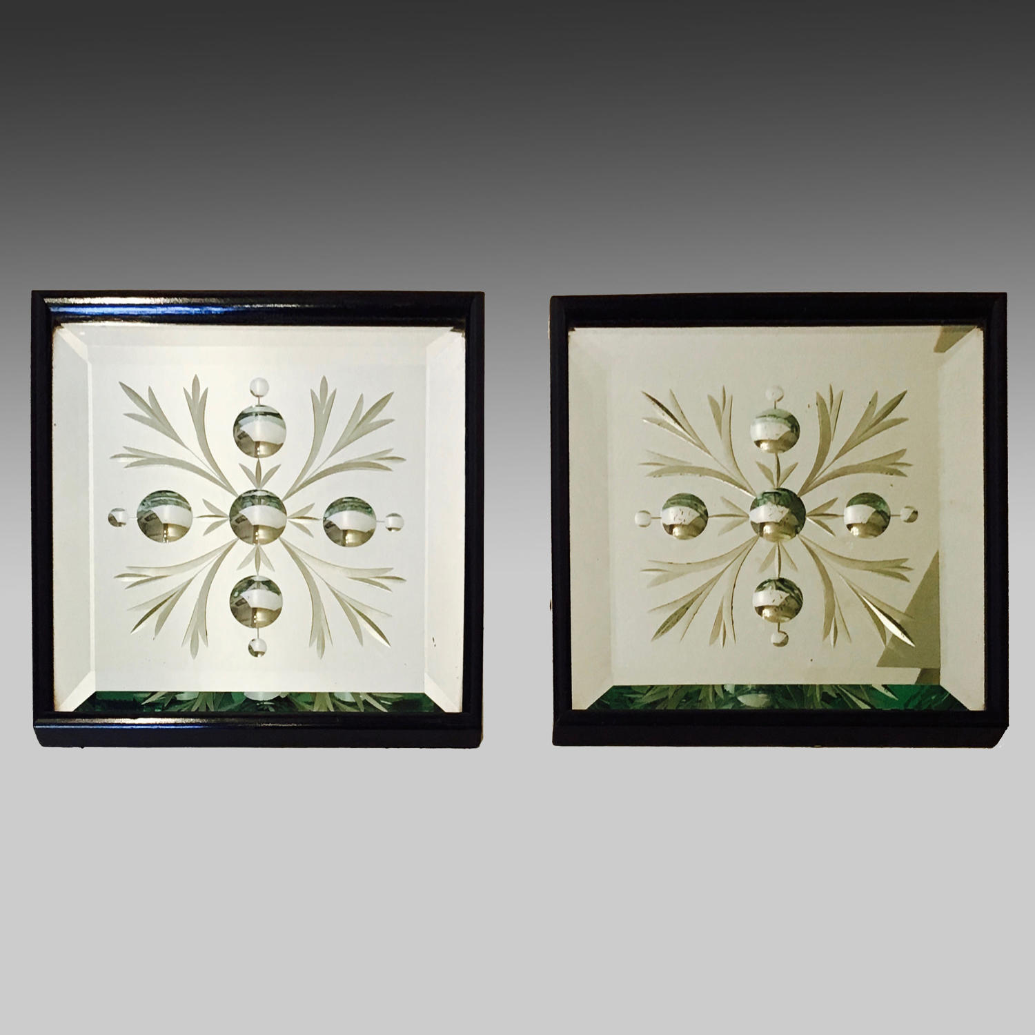 Pair of Art Nouveau mirrored wall plaques