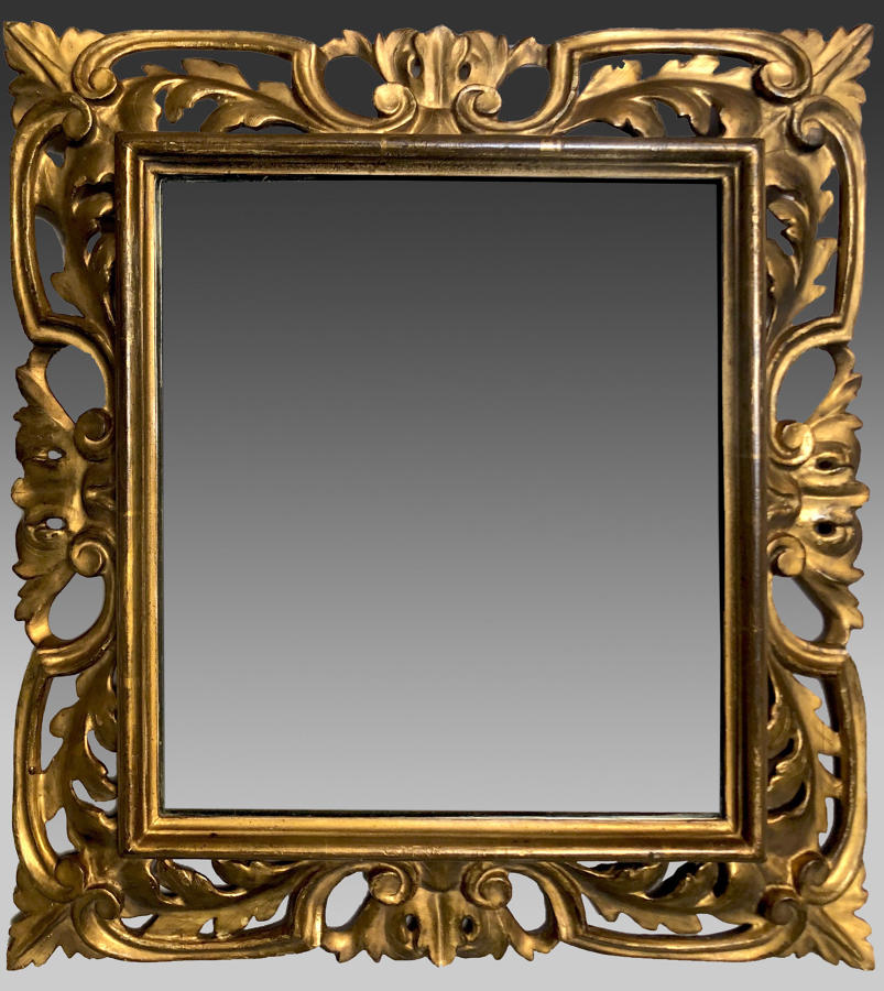 Continental rococo carved and gilded framed mirror