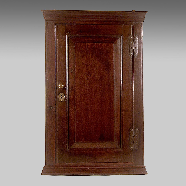 Small Georgian, oak hanging corner cupboard