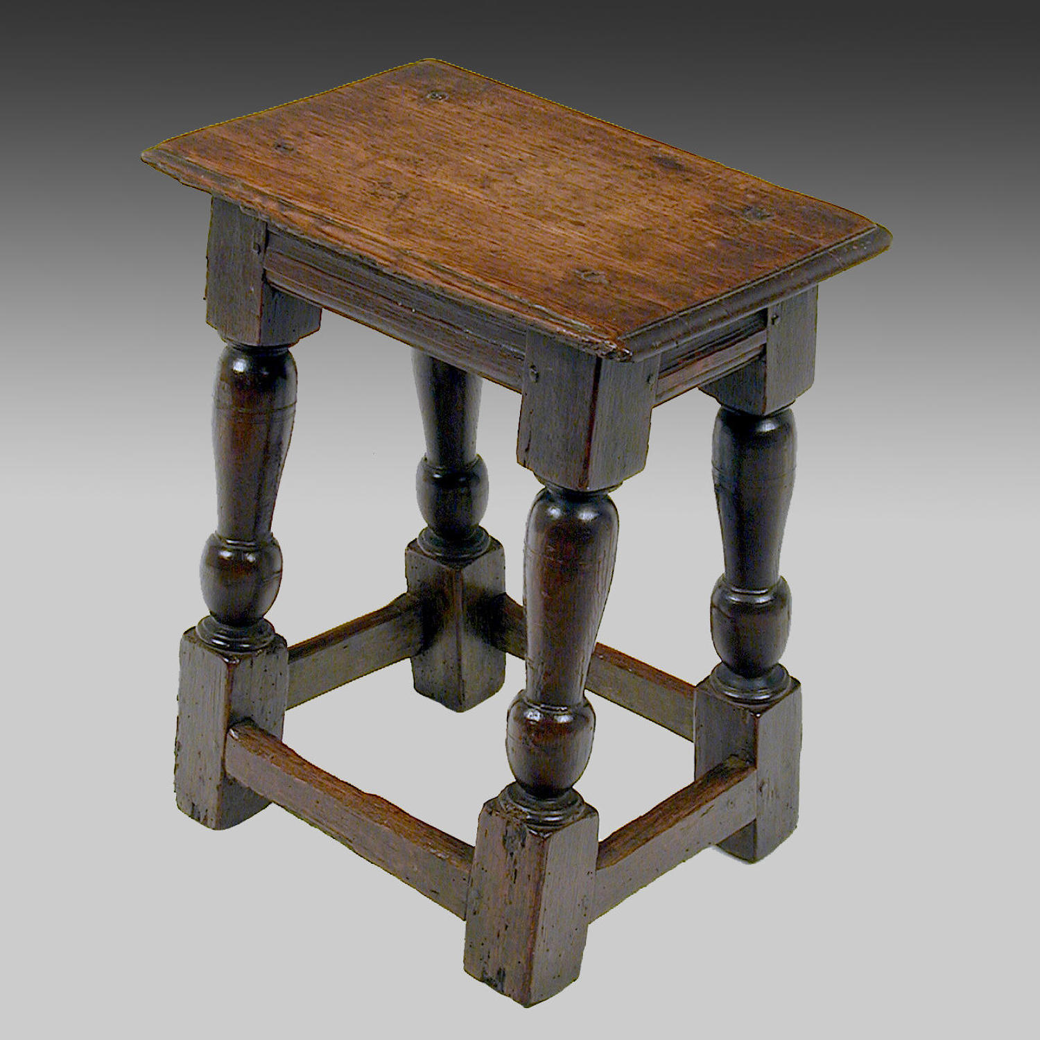 Early 17th century oak joined stool