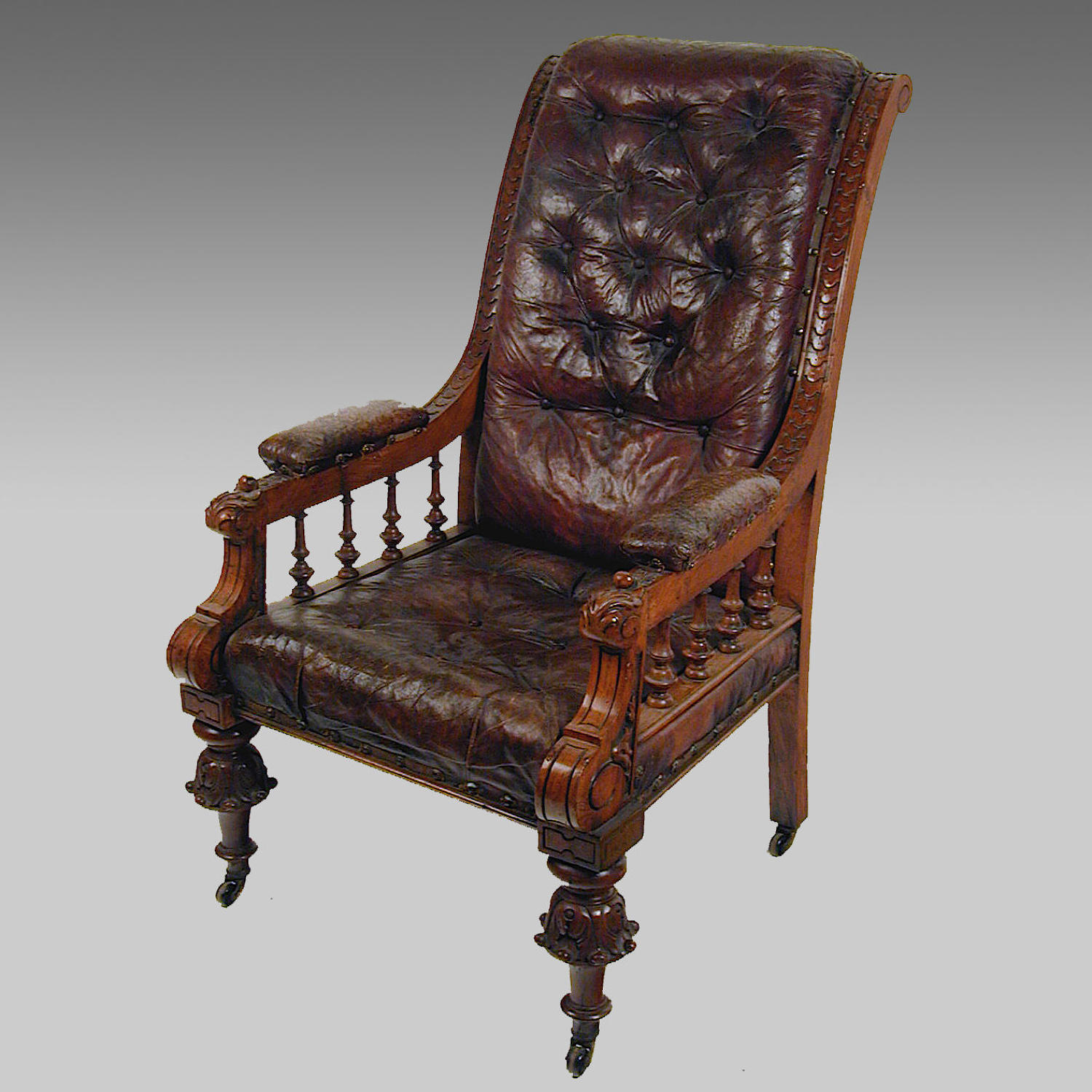 19th century oak and leather library armchair