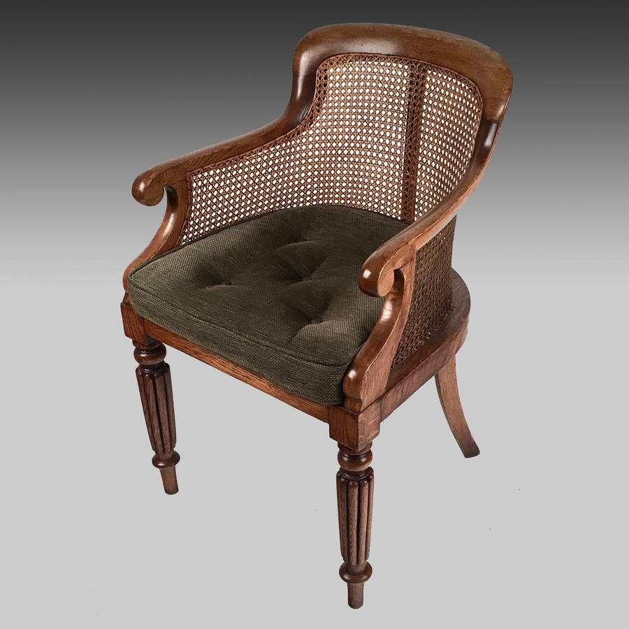 Regency oak Bergere library armchair