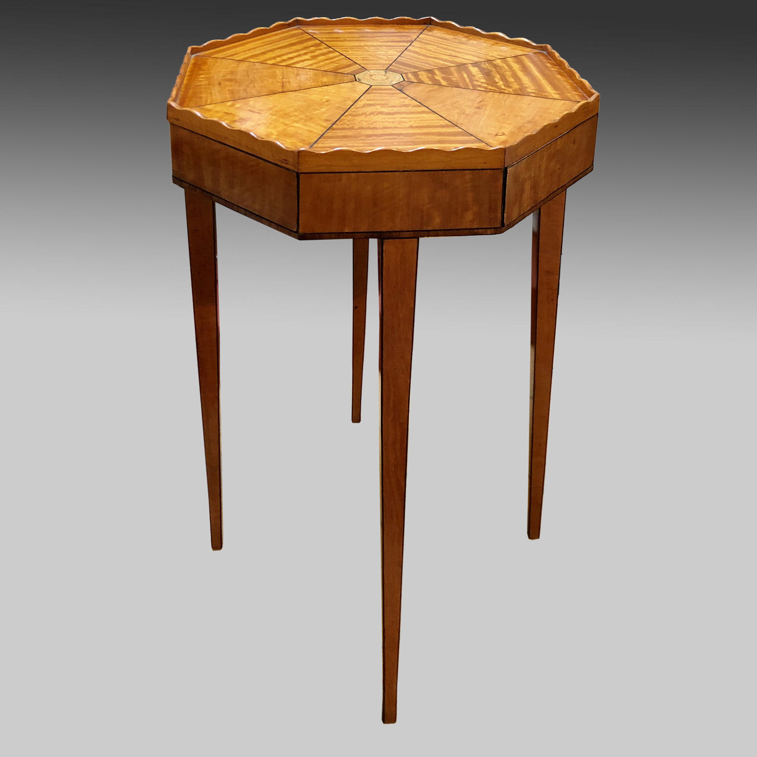 Late 18th century, octagonal satinwood centre table