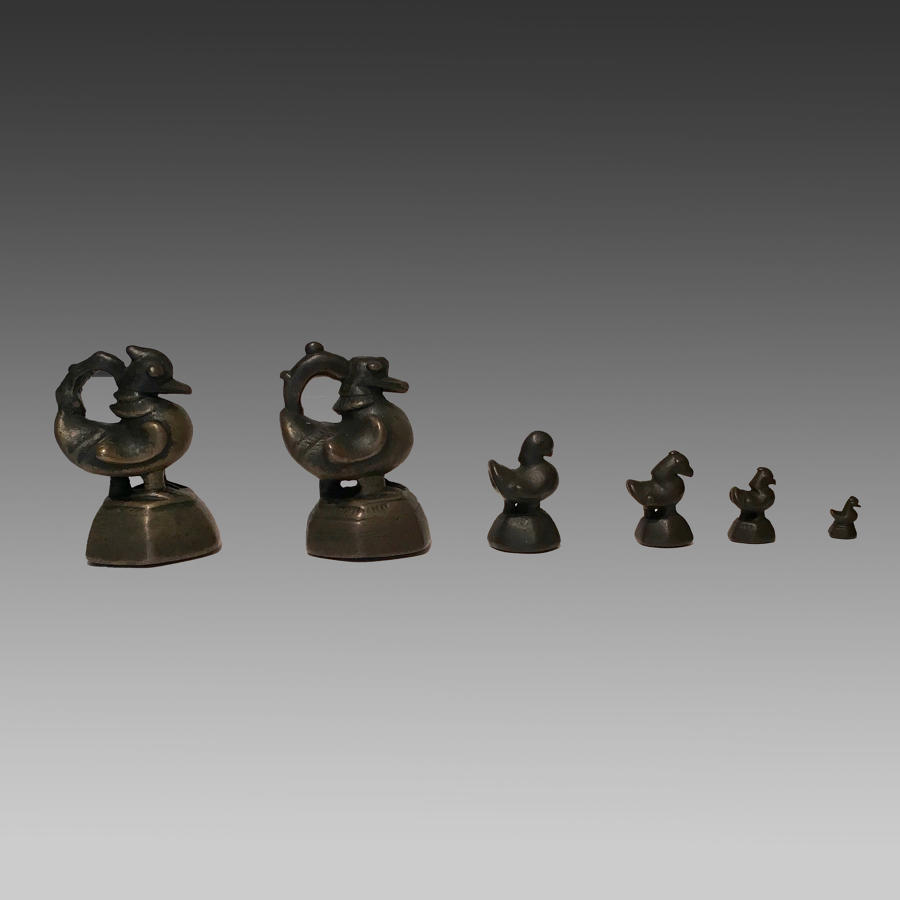 Six 19th century Burmese bronze 'opium' weights