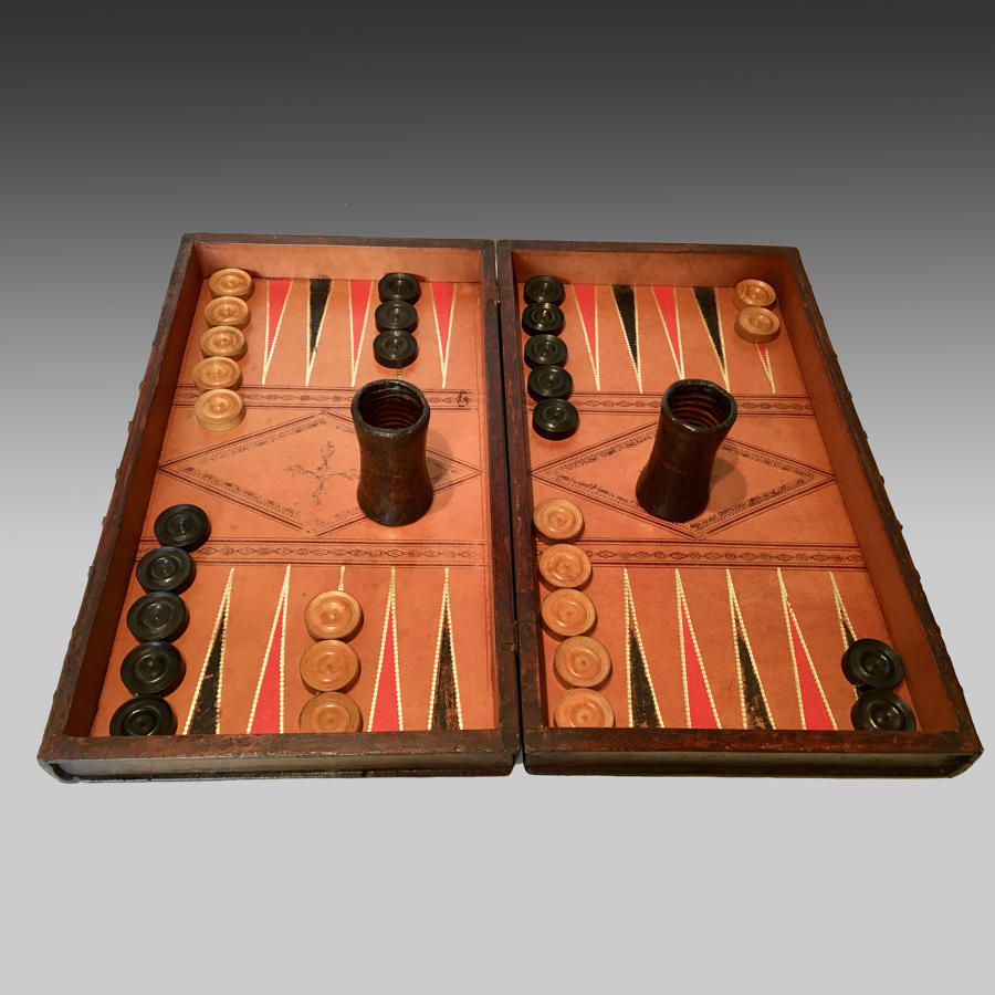 Antique leather-bound book games board
