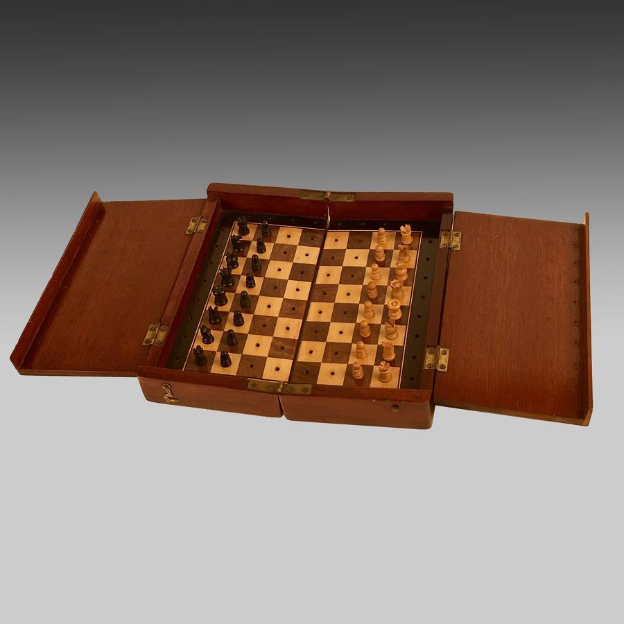 'The Whittington' mahogany cased travelling chess set