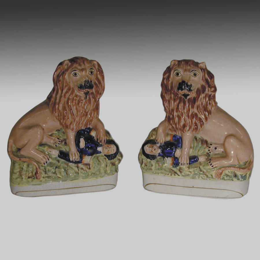 Antique pair Staffordshire pottery lions