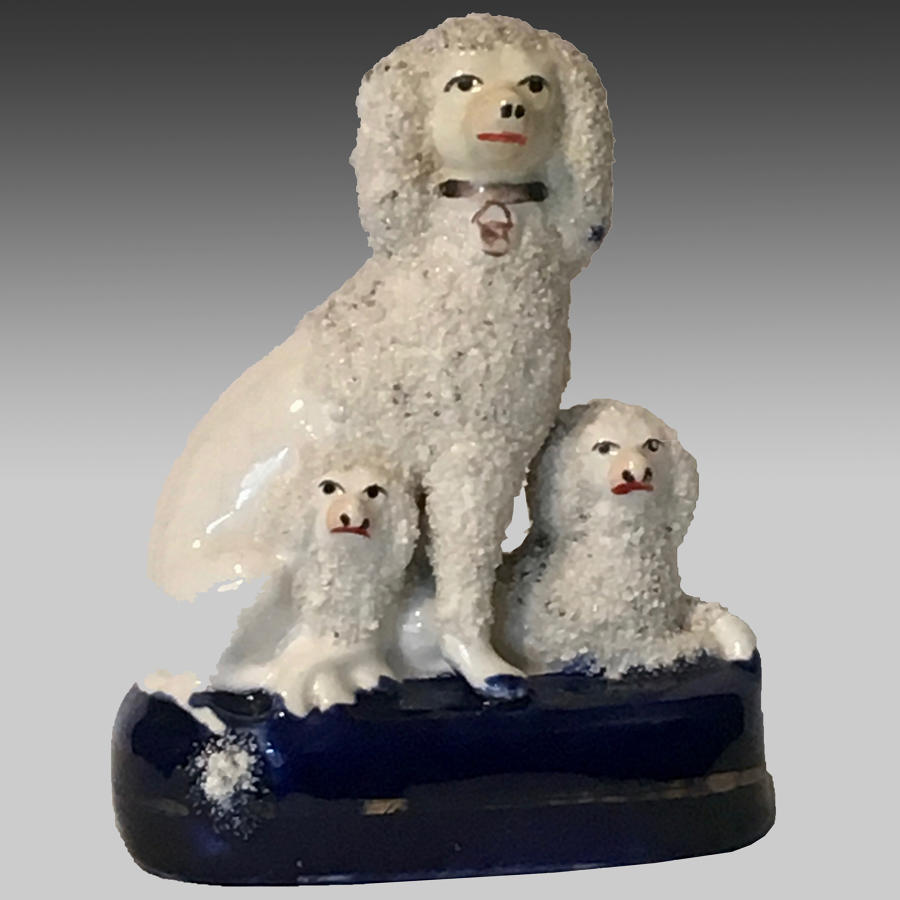 19th century Staffordshire pottery group of poodle & pups