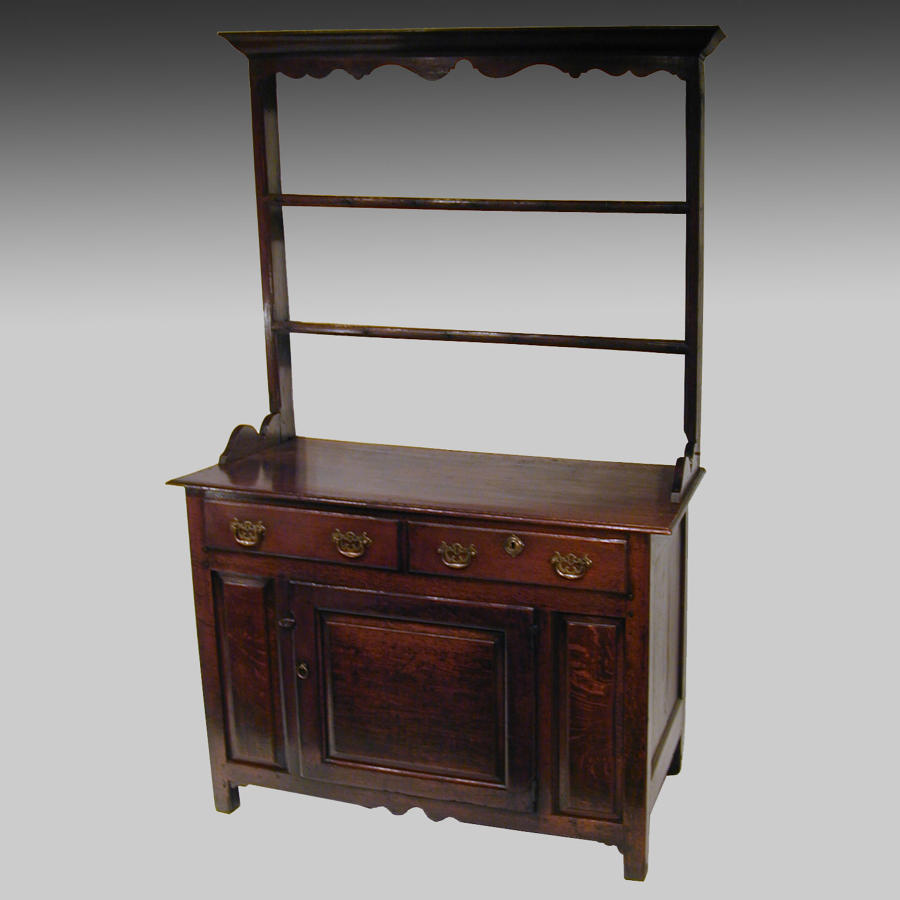 Small eighteenth century oak cupboard dresser and rack