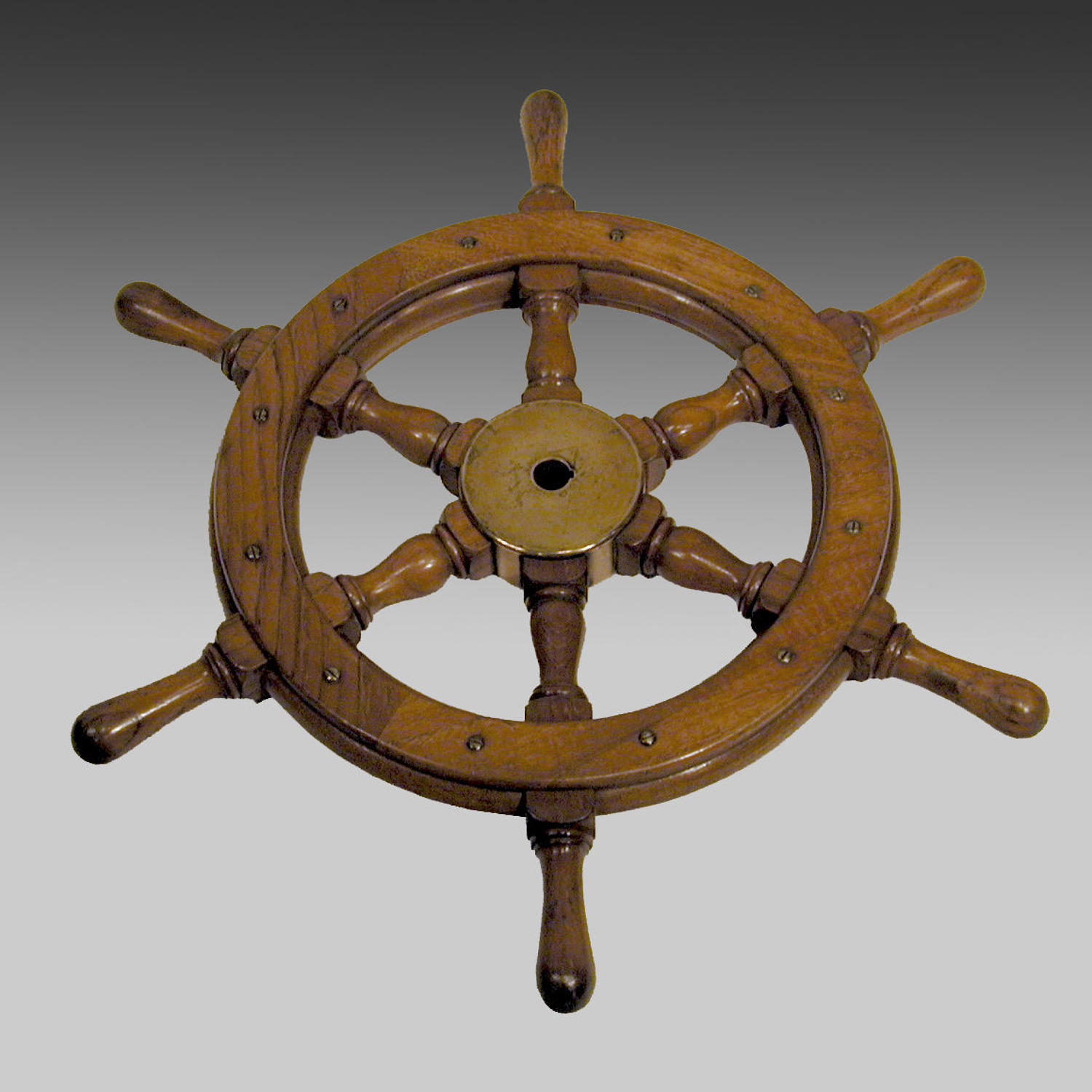 Padouk and bronze mounted ship's wheel.