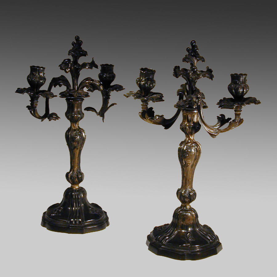 Pair 18th century continental rococo gilt bronze candlesticks