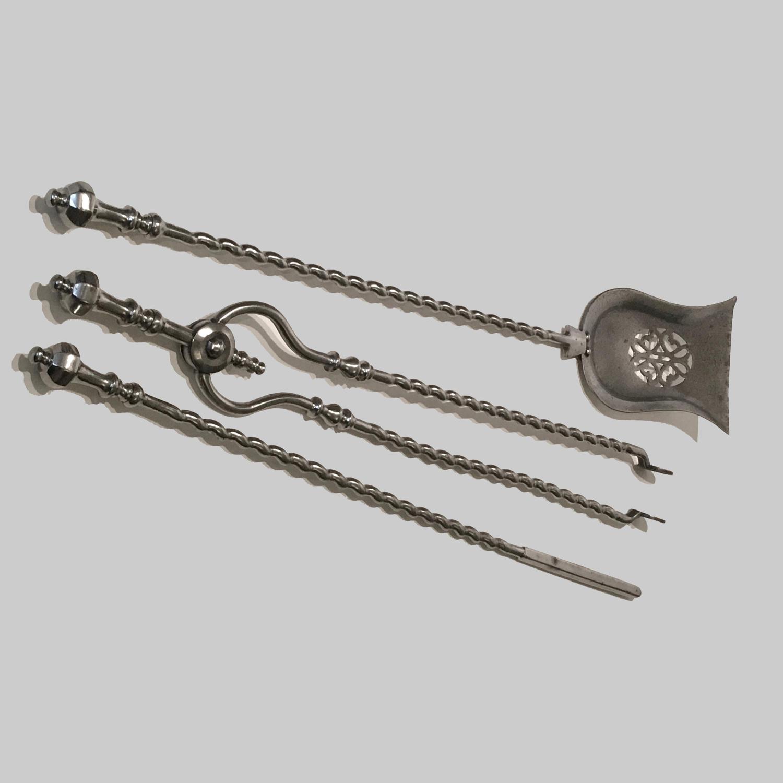 Set of Georgian cut steel fire irons