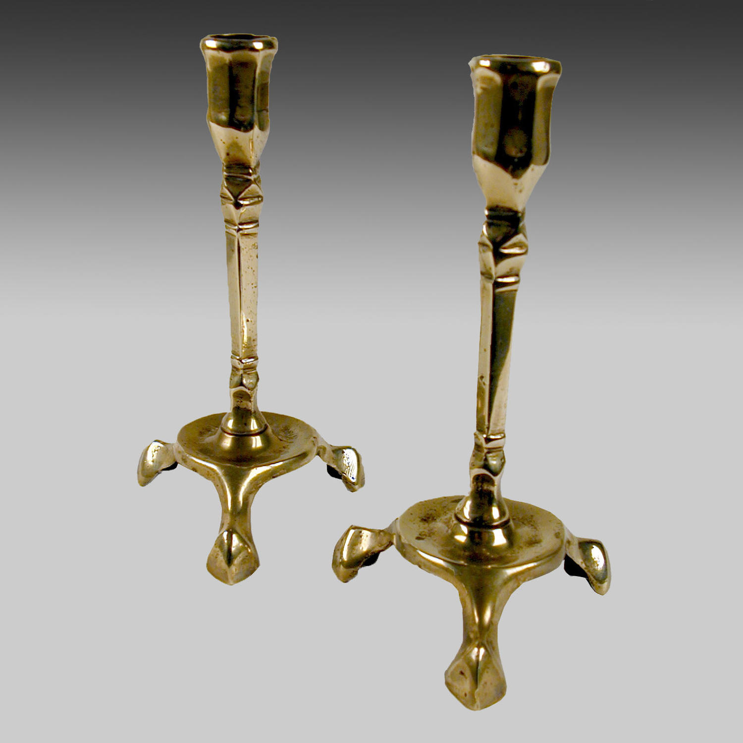 A rare pair18th century brass candlesticks
