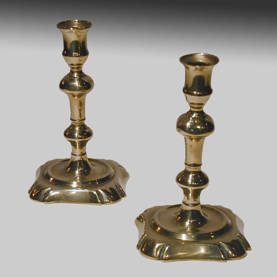 Pair of 18th century seamed brass candlesticks