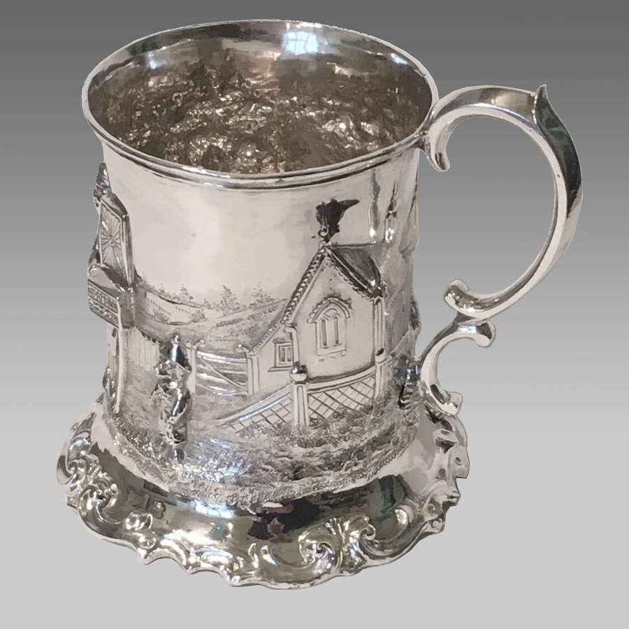 Fine antique repoussé silver tankard