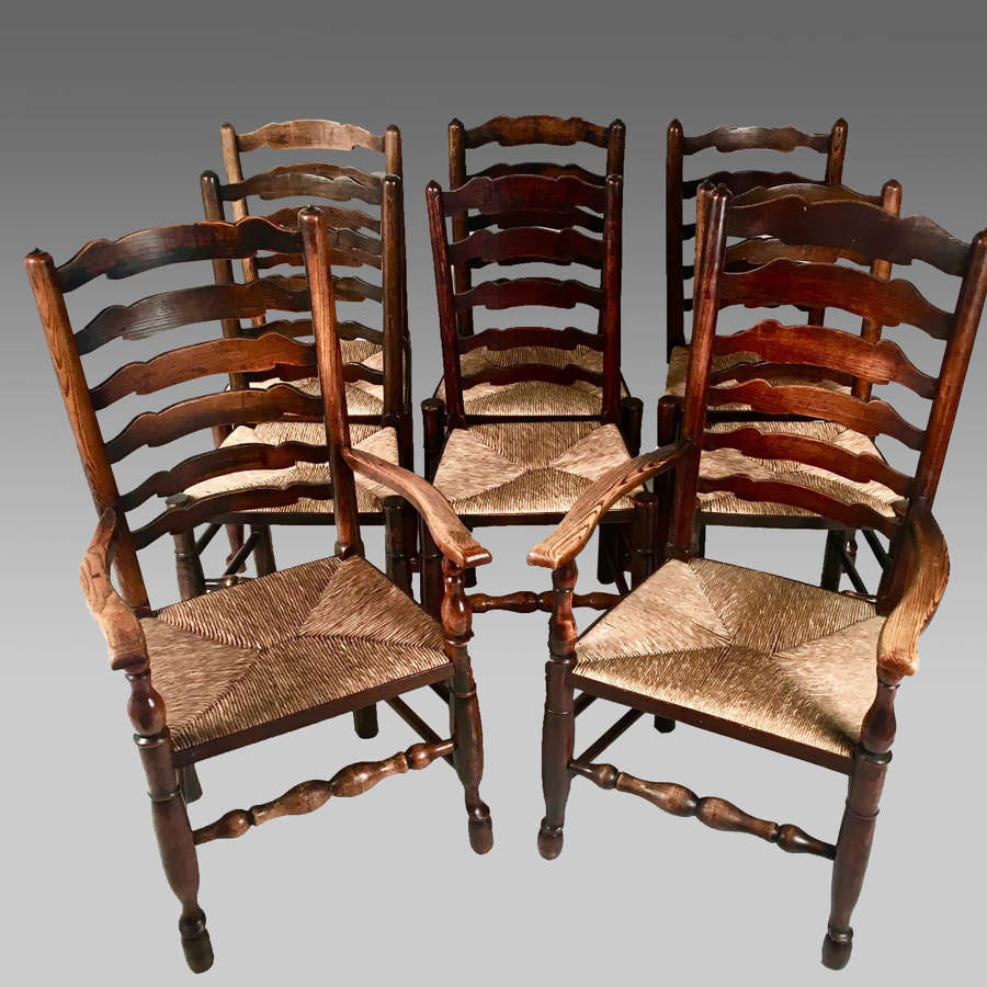 Eight rush seat antique Yorkshire ladder back chairs