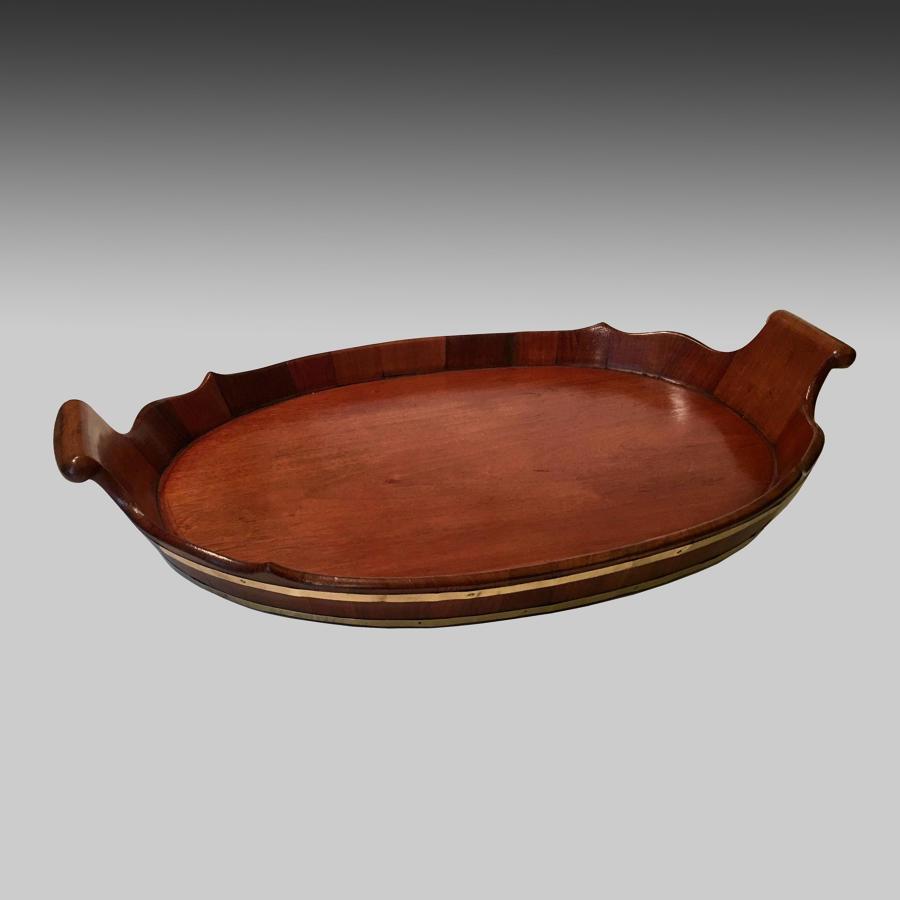 Georgian oval mahogany brass bound tray