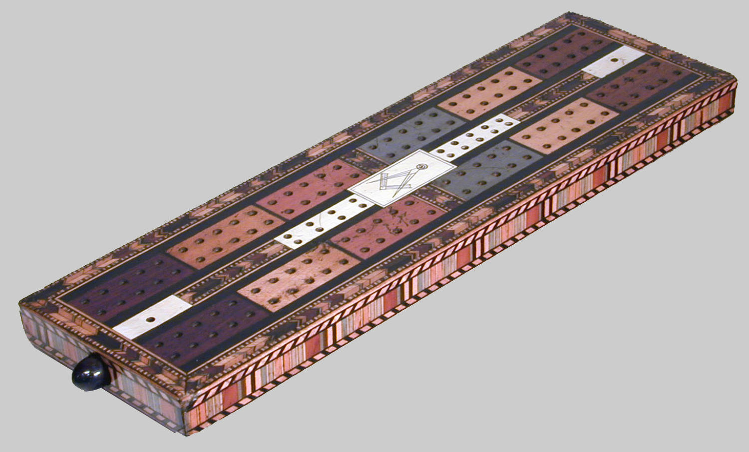19th century cribbage board with Masonic device