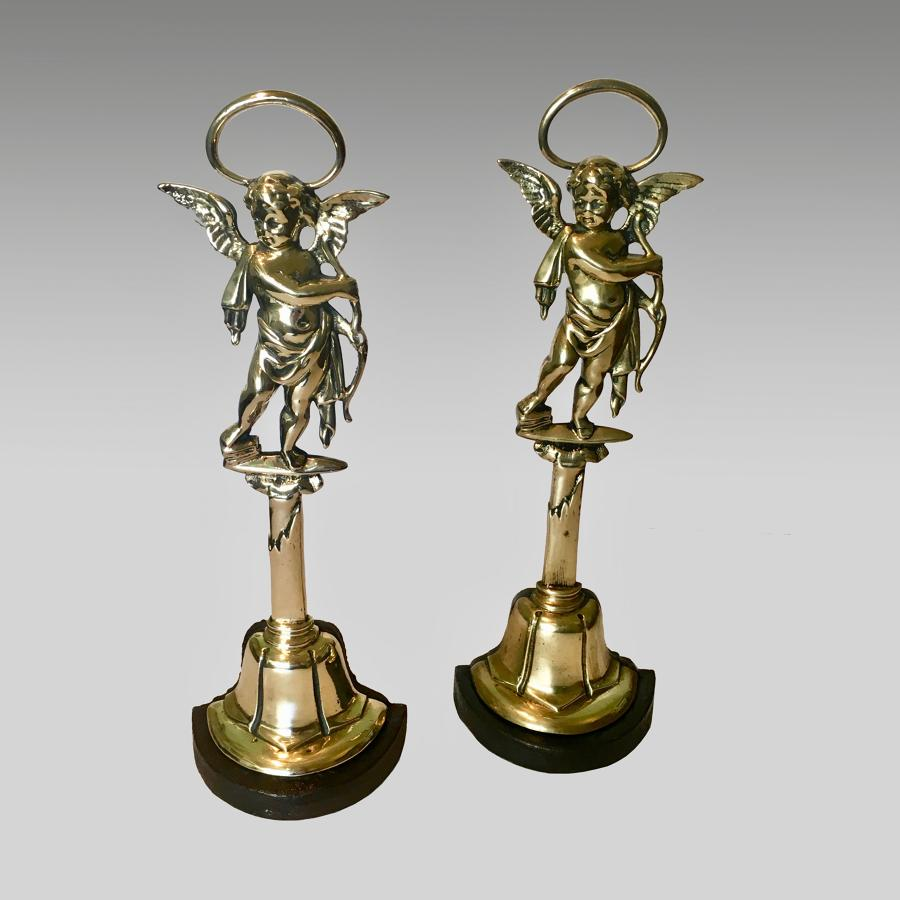 Pair of antique 19th century brass and cast iron doorstops