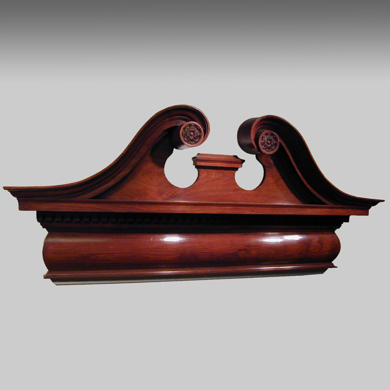 Pair of antique 19th century mahogany over door pediments.