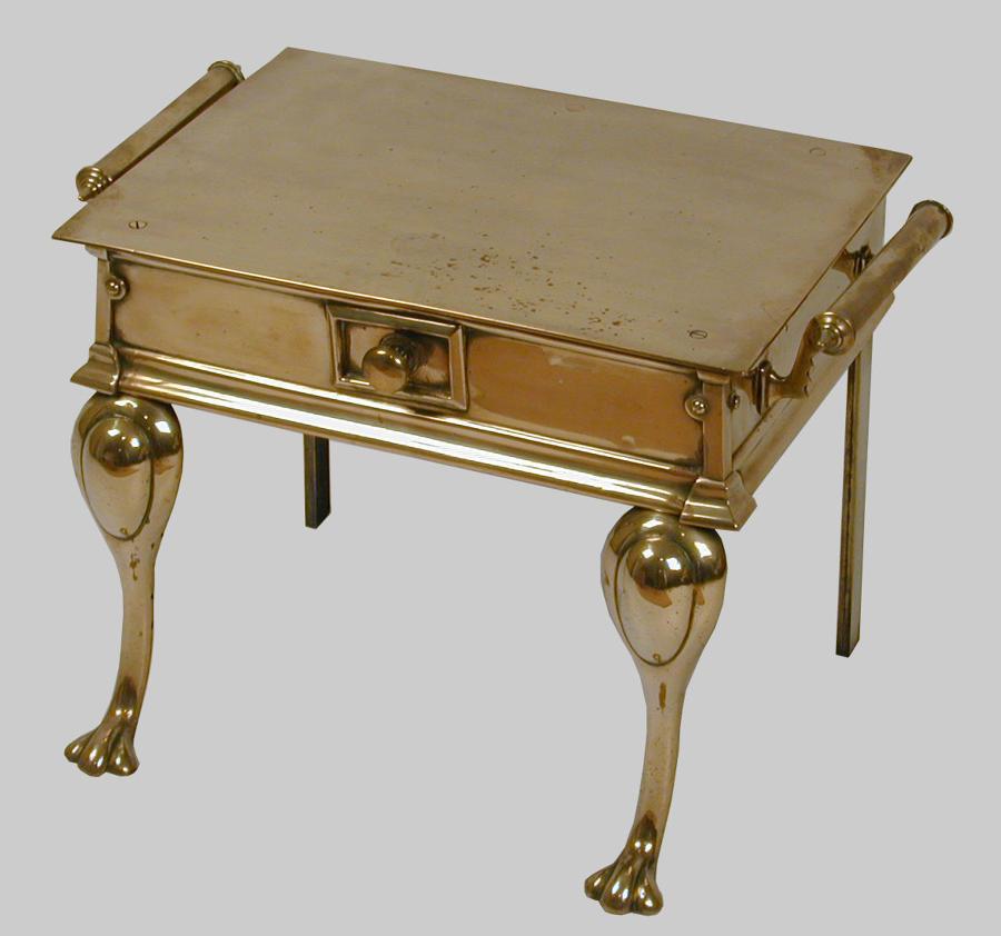 Antique cast brass footman or hearth trivet