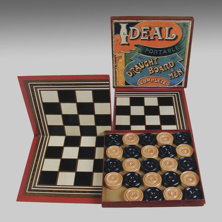 Antique set of 'Ideal' draughtsmen with board