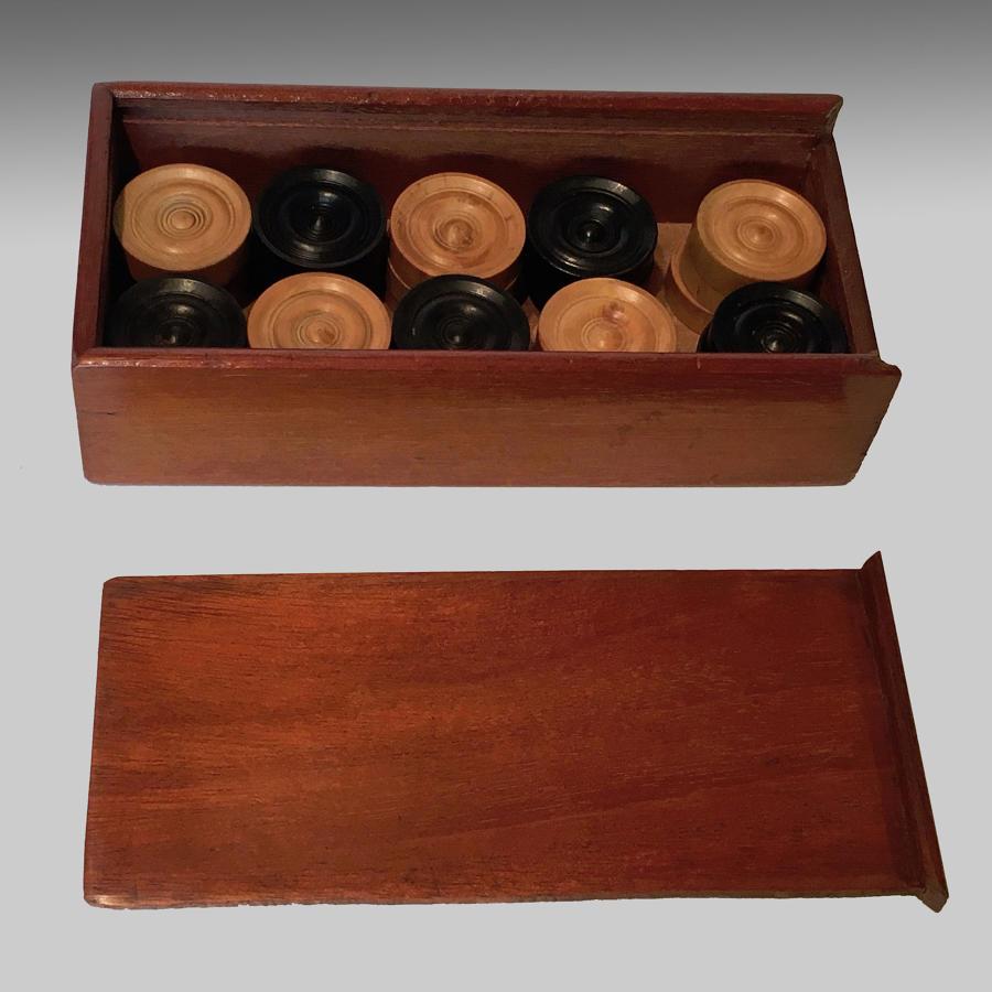 Boxed set of boxwood and ebony backgammon or draughts