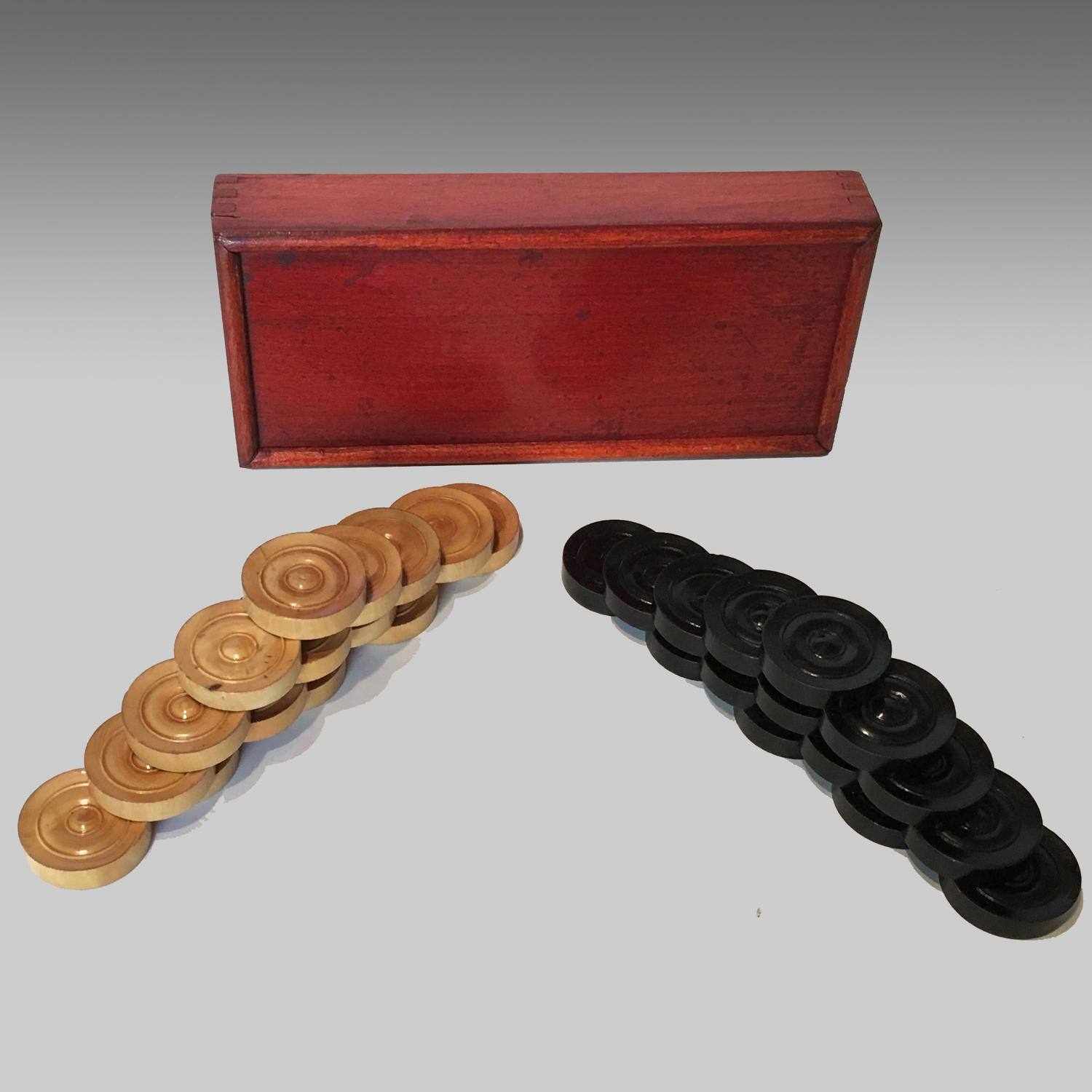 Boxed set of boxwood and ebony backgammon or draughtsmen