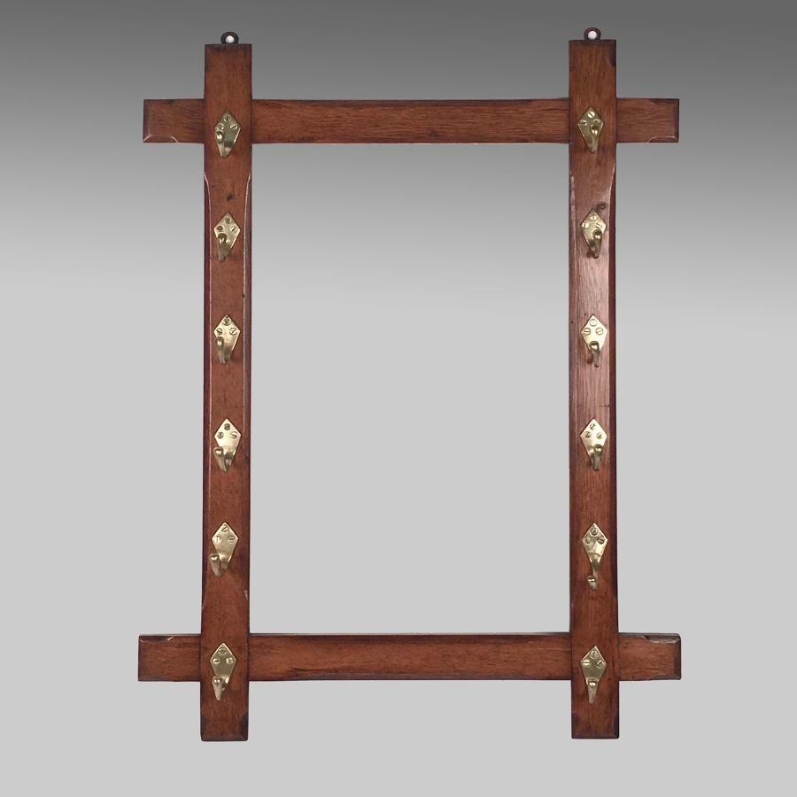Antique Aesthetic style blond oak whip rack
