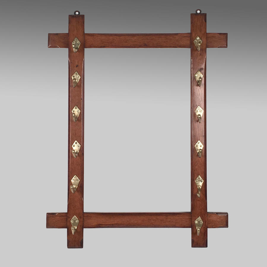 Antique Aesthetic style blond oak whip rack