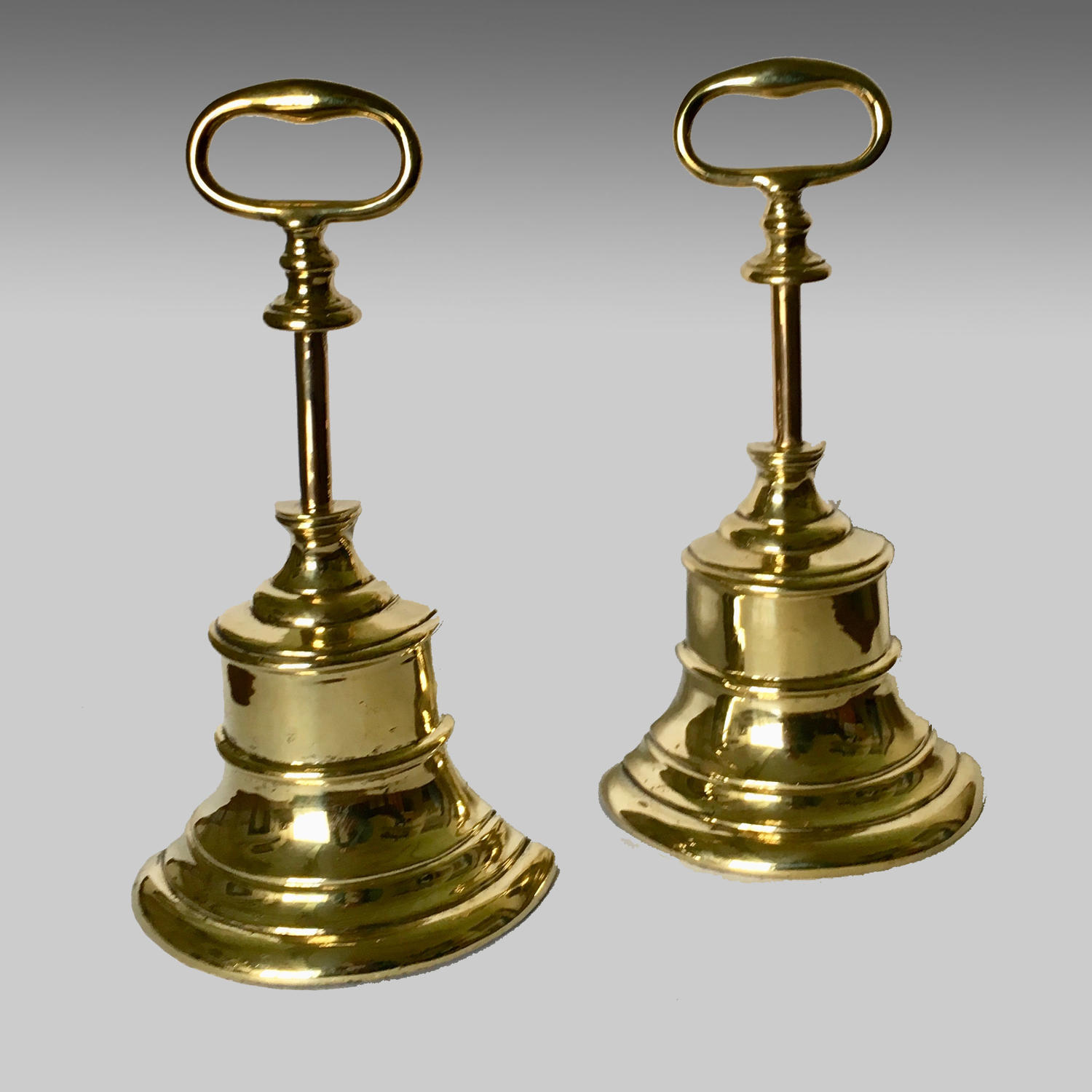 Pair of antique brass doorstops