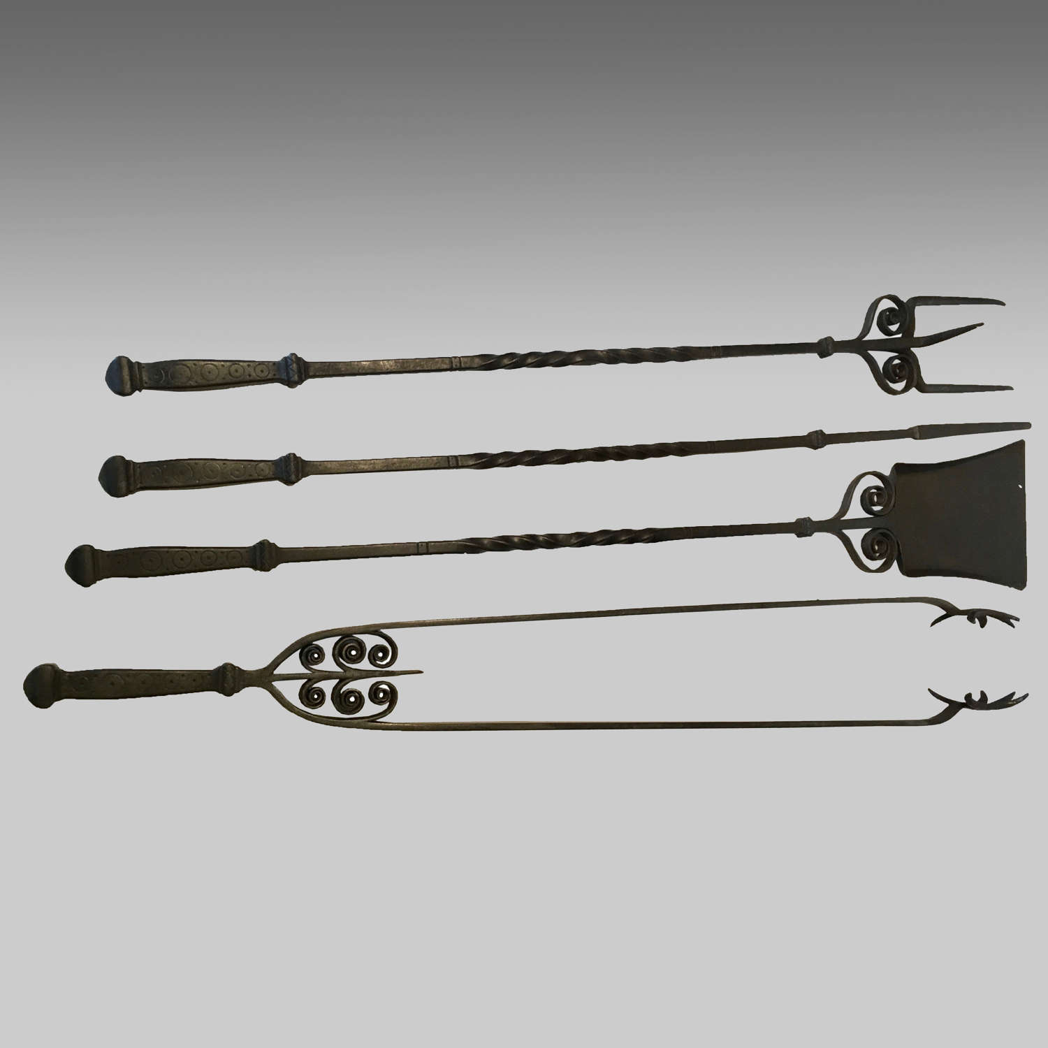 Set of impressive Arts & Crafts wrought iron fire tools