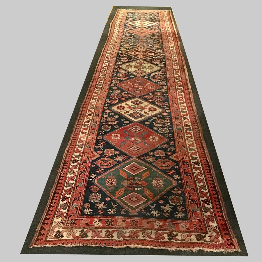 Pair of antique Caucasian Kazakh carpet runners