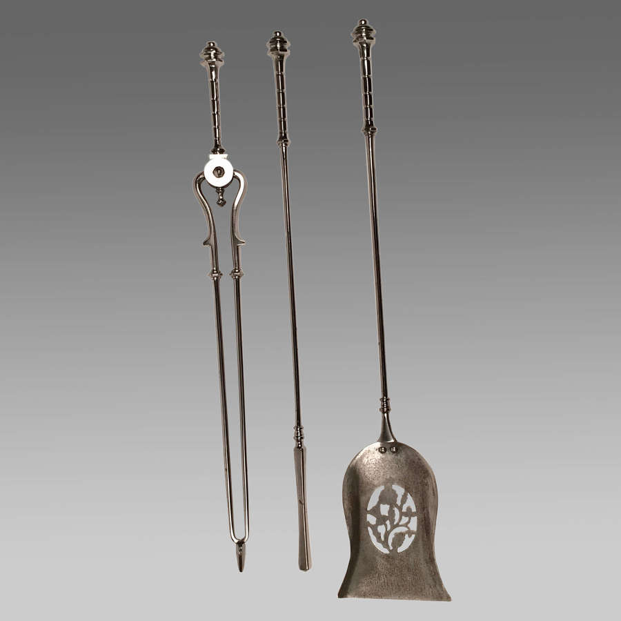 Set of Georgian cut steel fire irons
