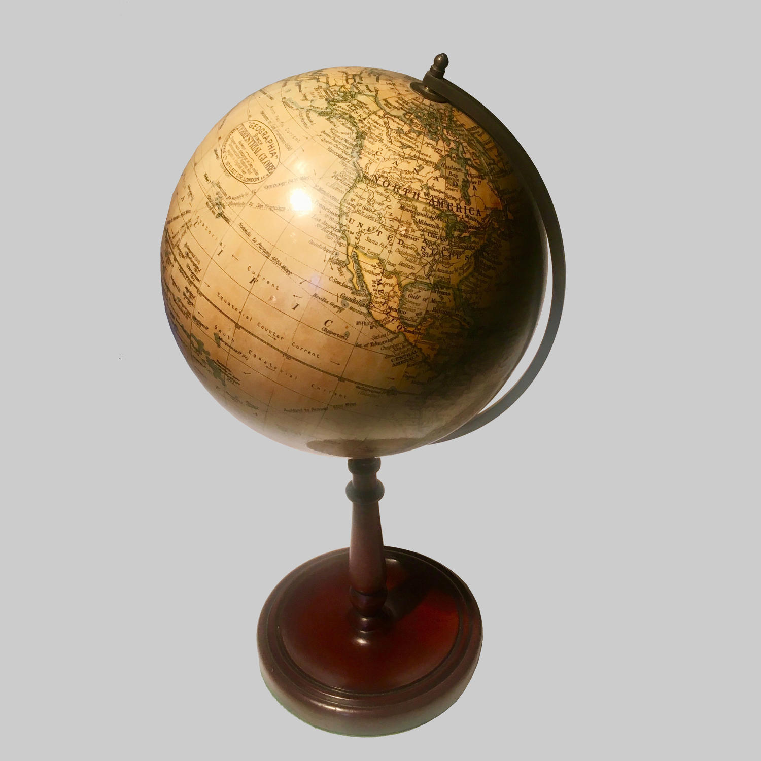 Terrestial globe on mahogany stand by Geographia Ltd.