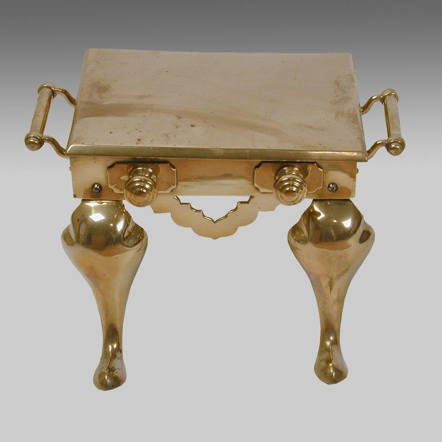 Antique cast brass footman or hearth trivet.