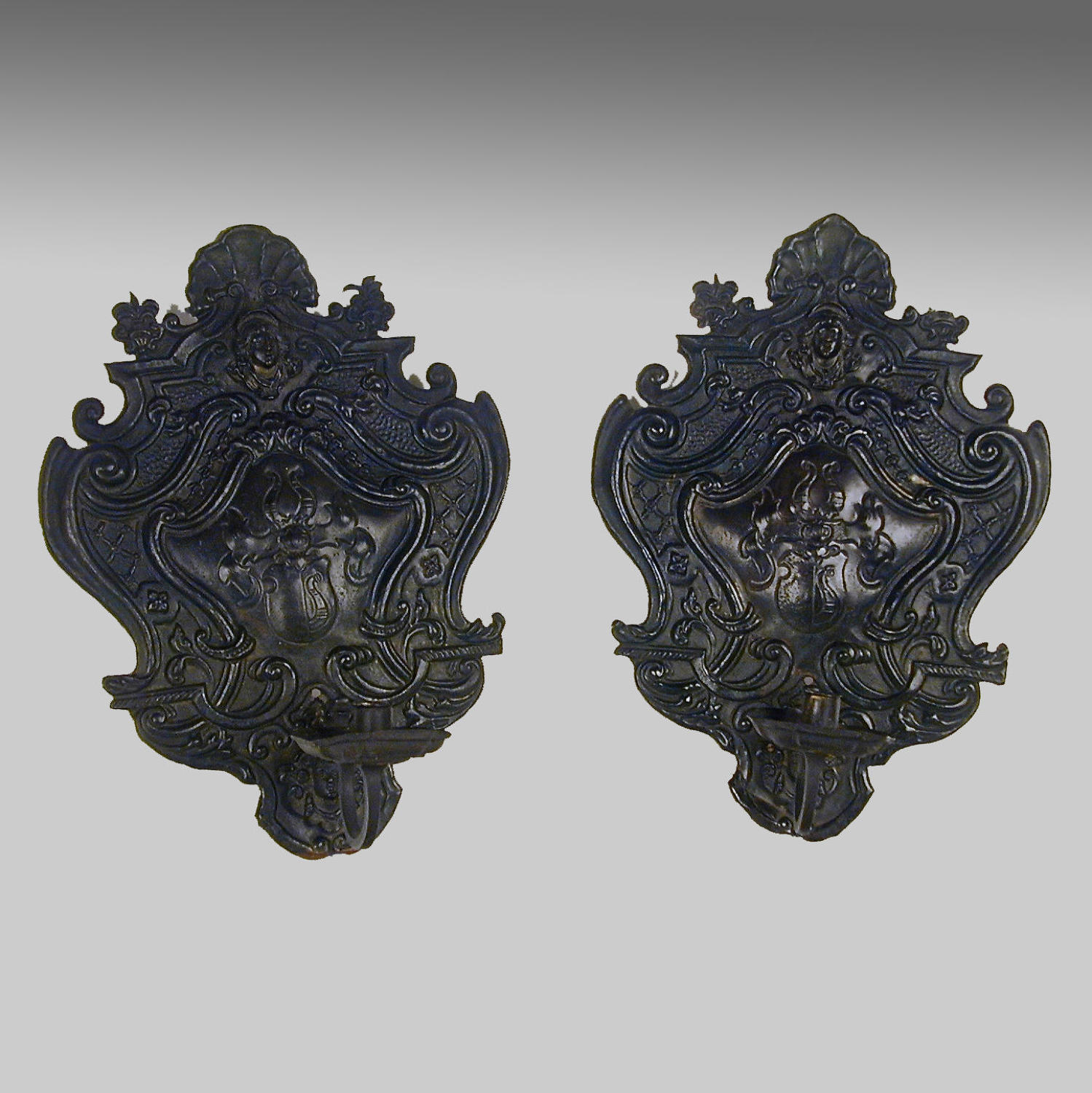 Pair of continental patinated brass wall sconces