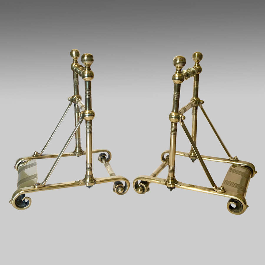 A pair Aesthetic Movement brass fire tool rests