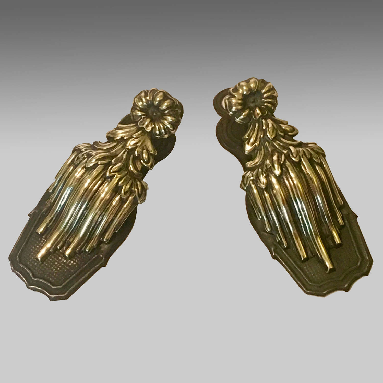 Pair of antique brass repoussé stationery clips