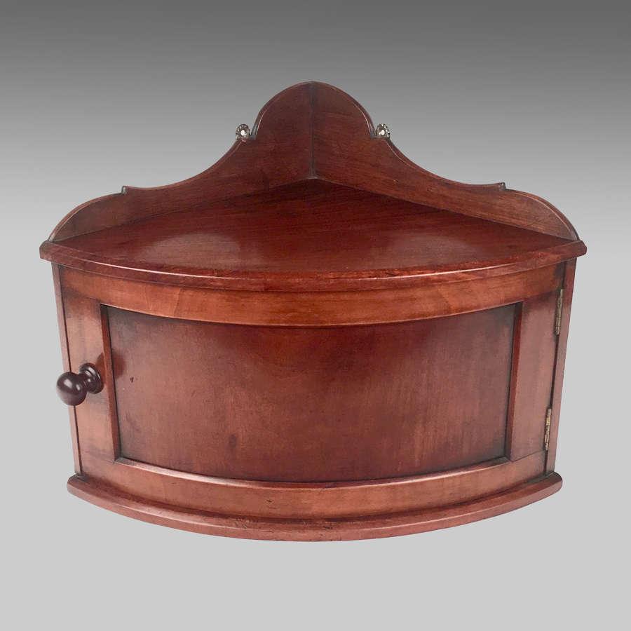 19th century mahogany bow-front corner cabinet