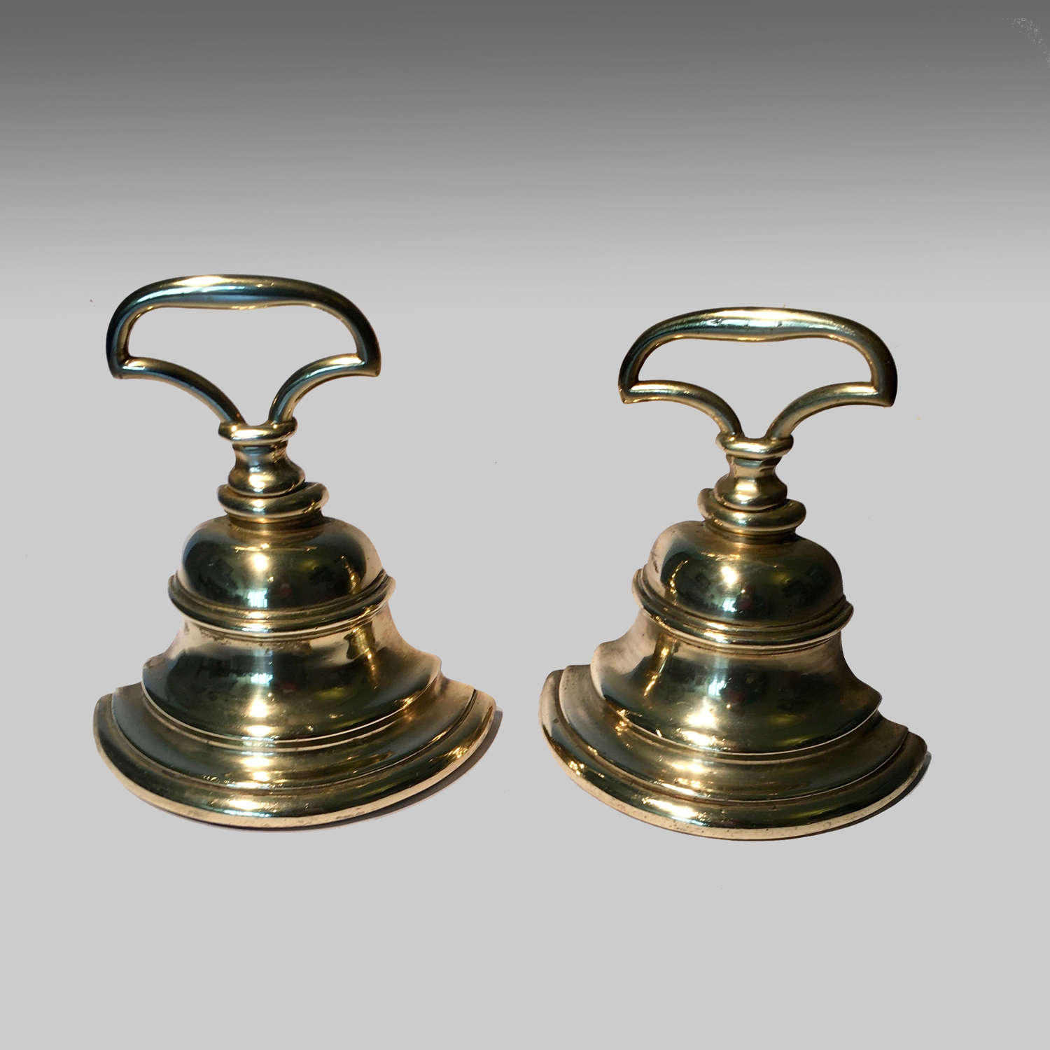 19th century pair brass doorstops