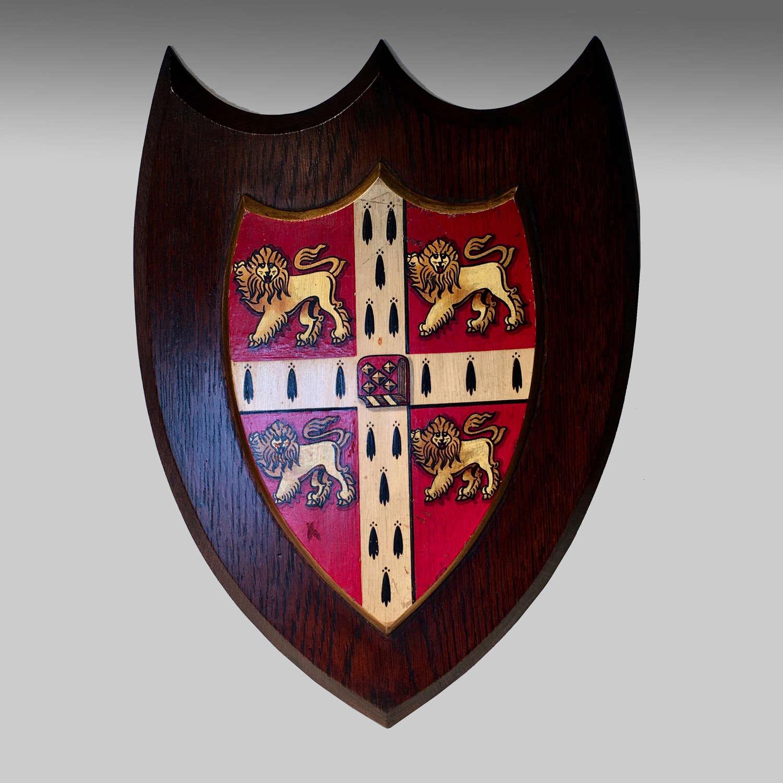 Vintage armorial oak shield for the University of Cambridge