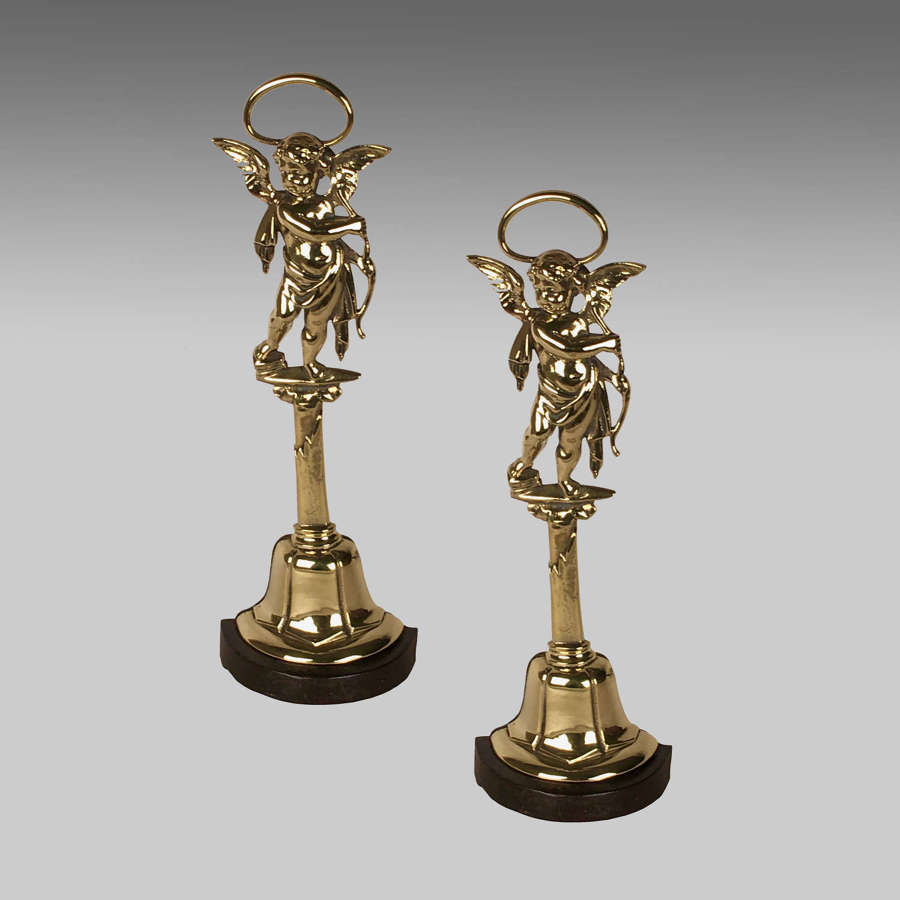 A pair of brass and cast iron doorstops