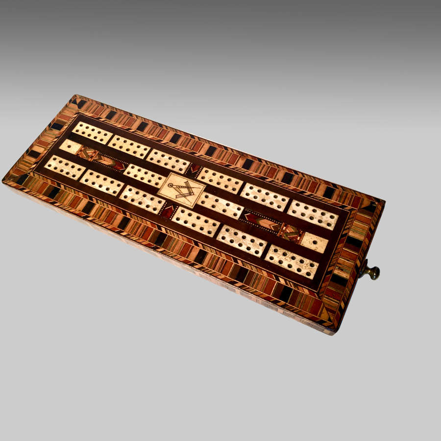 Mid 19th century parquetry inlaid cribbage board.