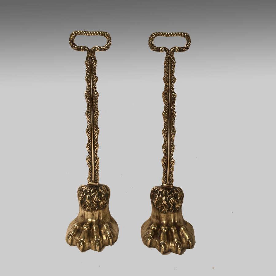 Pair Regency brass lion's paw doorstops