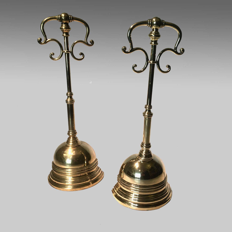Two Regency brass door porters