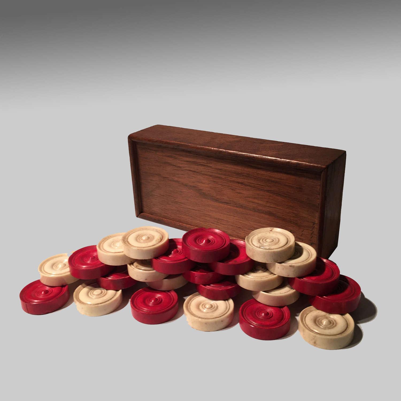 Boxed set of bone backgammon checkers